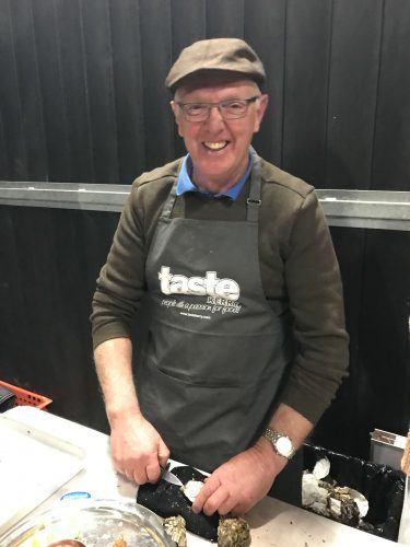 older man shucking oysters killarney ireland