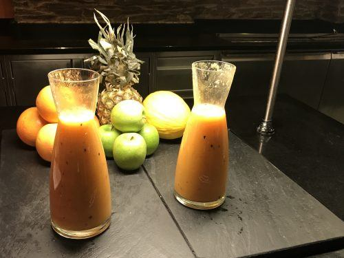 2 carafes of juice and pineapple and fruit on breakfast buffet at Arosa Kitzbühel