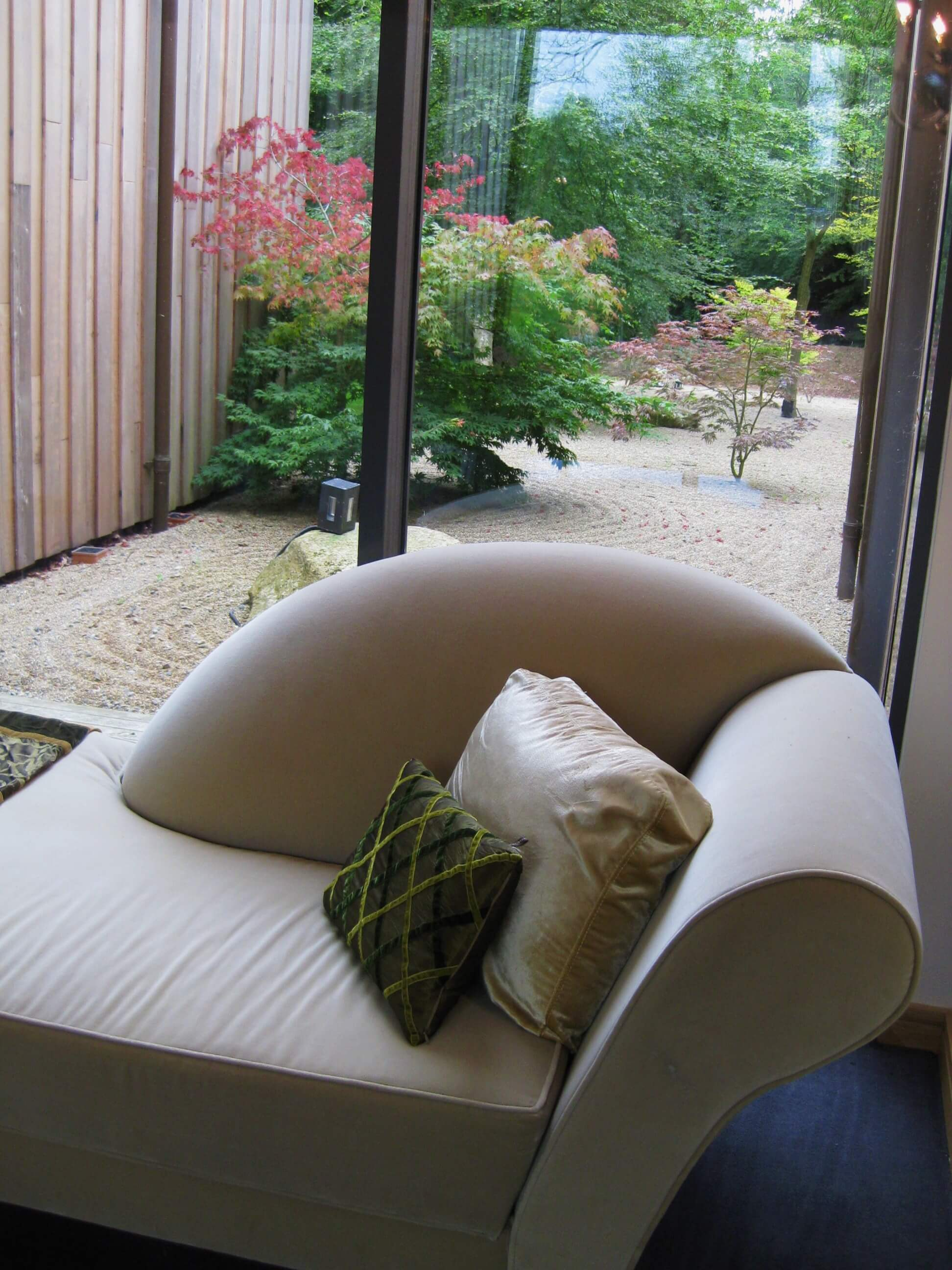chaise lounge with view of outside area in room at monart spa ireland