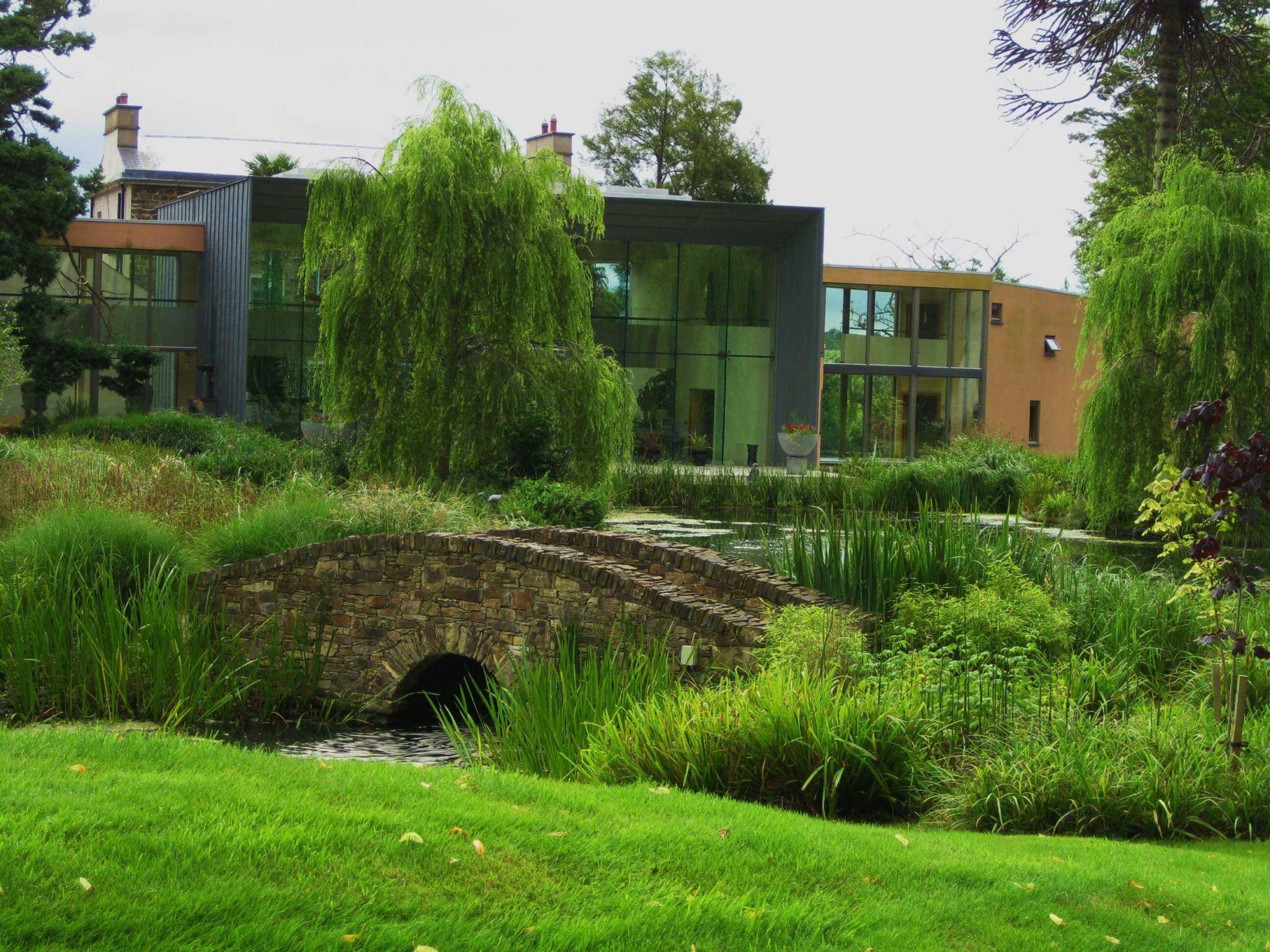 grounds of monart spa ireland including stone bridge and main spa buildings