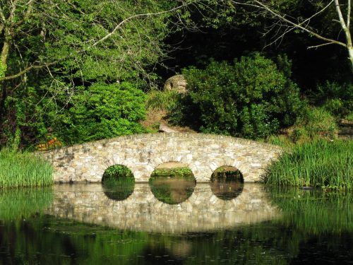 bridge reflected in lake monart spa ireland