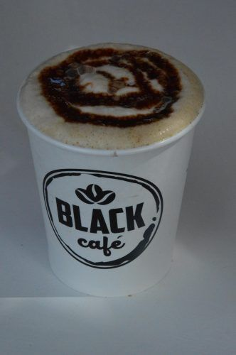 Coffee with chocolate sauce on top from Black Cafe Guatape