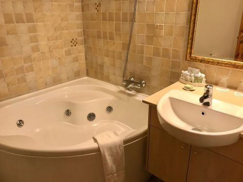 bath and sink in bathroom at hotel ranga iceland