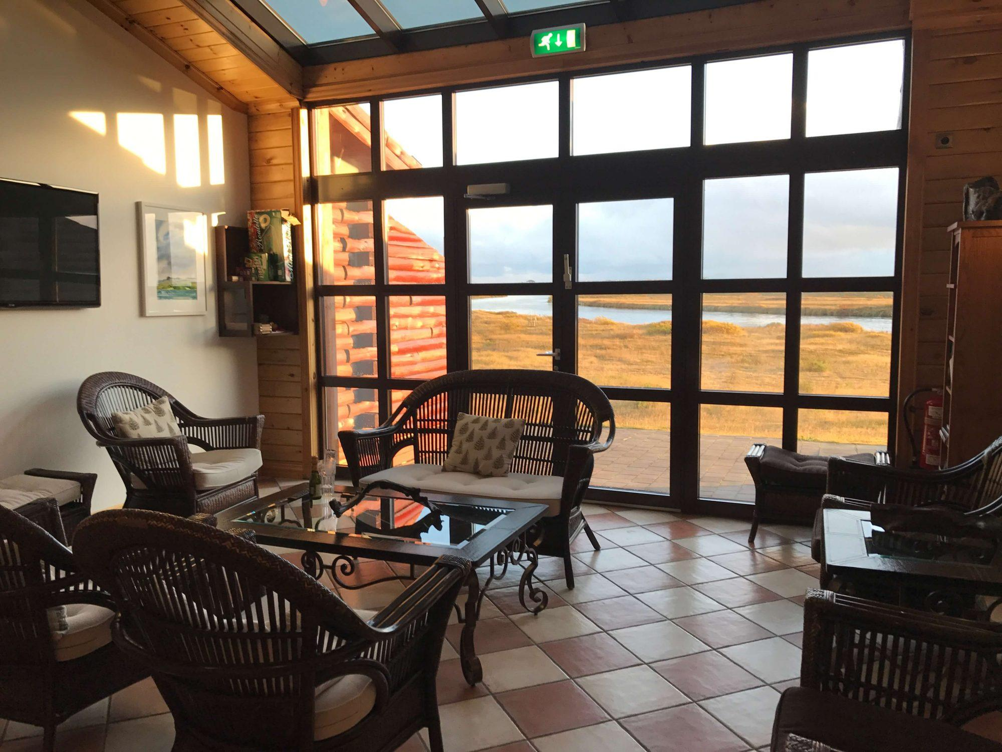 Hotel Ranga Iceland table and chairs area with windows to outside