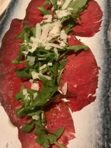 reindeer carpaccio with rocket and parmesan starter item on menu at hotel ranga iceland