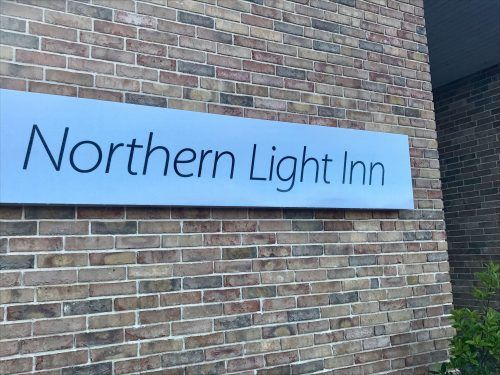 northern light inn sign iceland