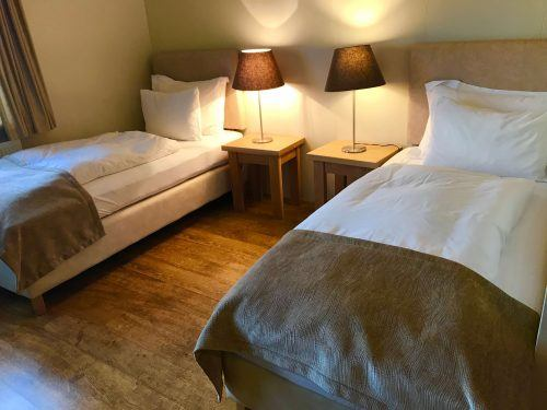 twin beds and lamps room at northern lights inn iceland