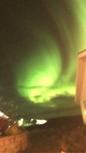 northern lights over the northern lights inn iceland