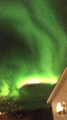 northern lights over the northern lights inn iceland