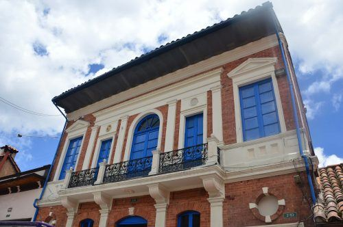 classic blue building in La Candeleria Bogota things to do in bogota colombia