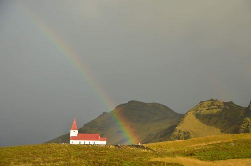 rainbow over church Vik iceland