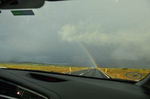 rainbow through a car windscreen iceland