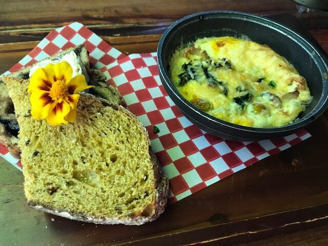 baked eggs and toast on checked napkin at Park 37 medellin restaurant