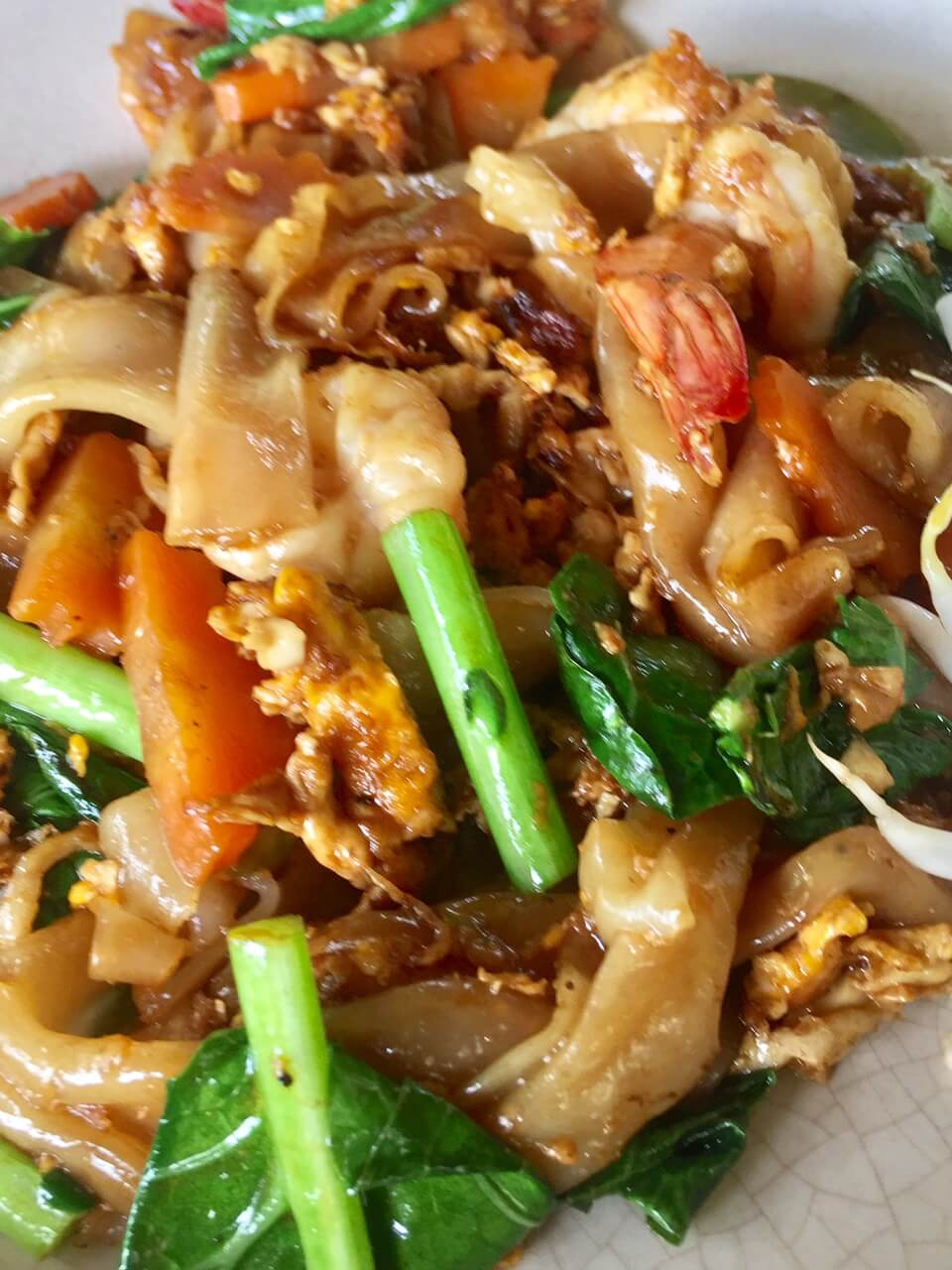 close up of pad thai on a white plate