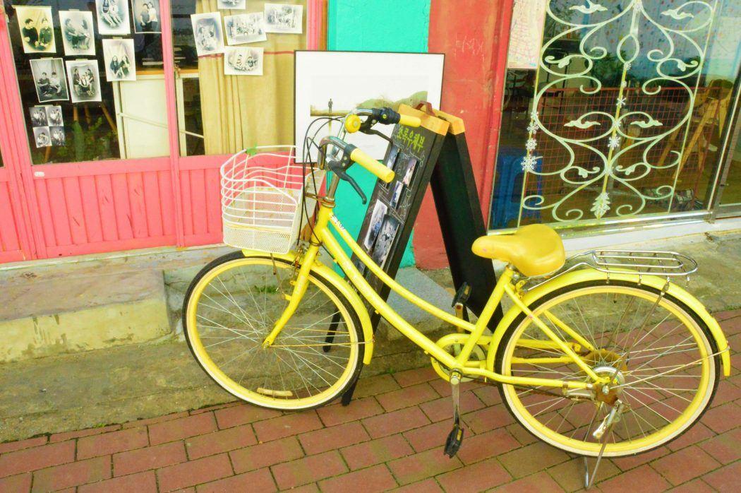 yellow bike outside kim kwang-seok street in daegu