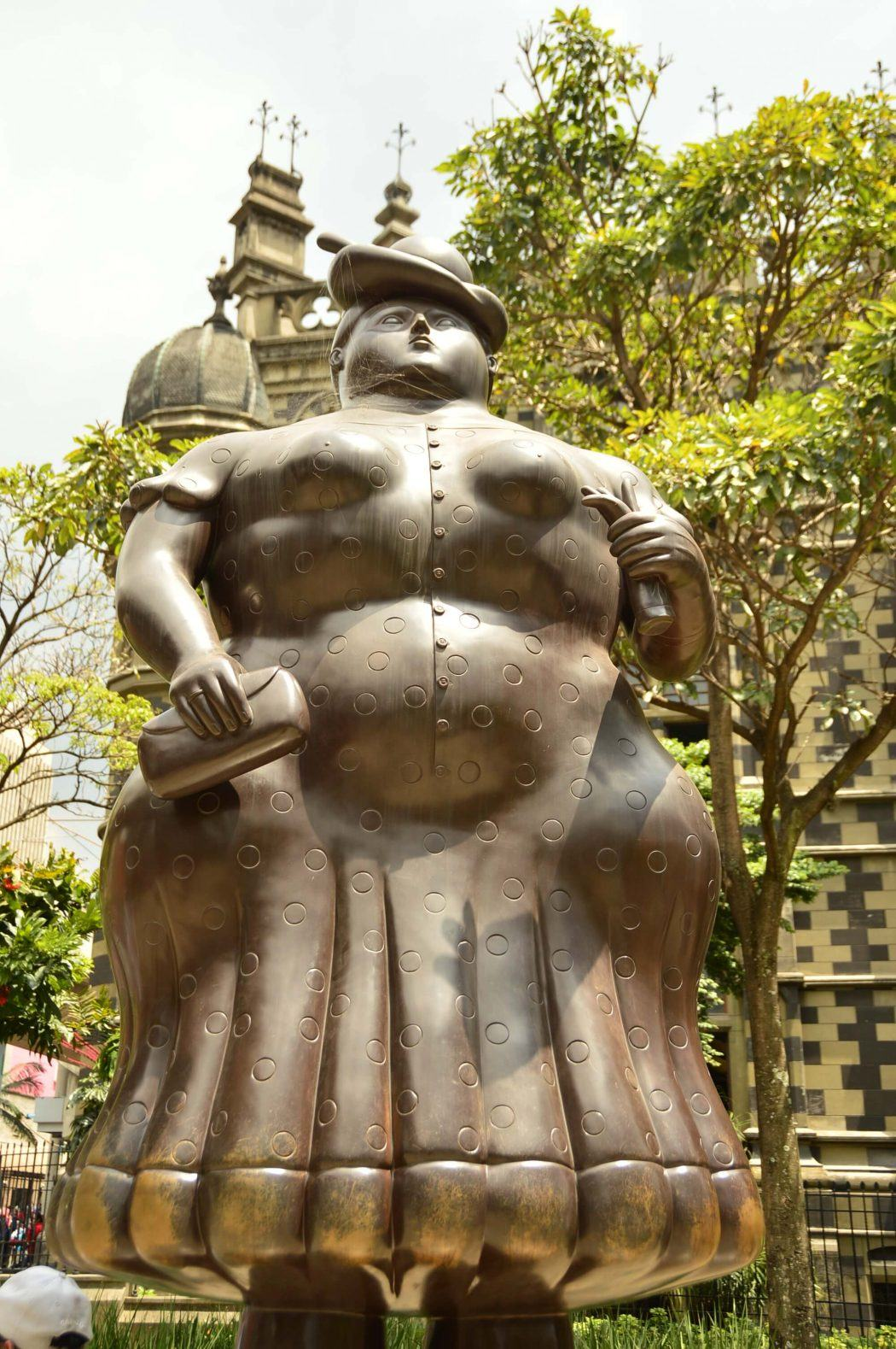 botero sculpture of woman in plaza botero
