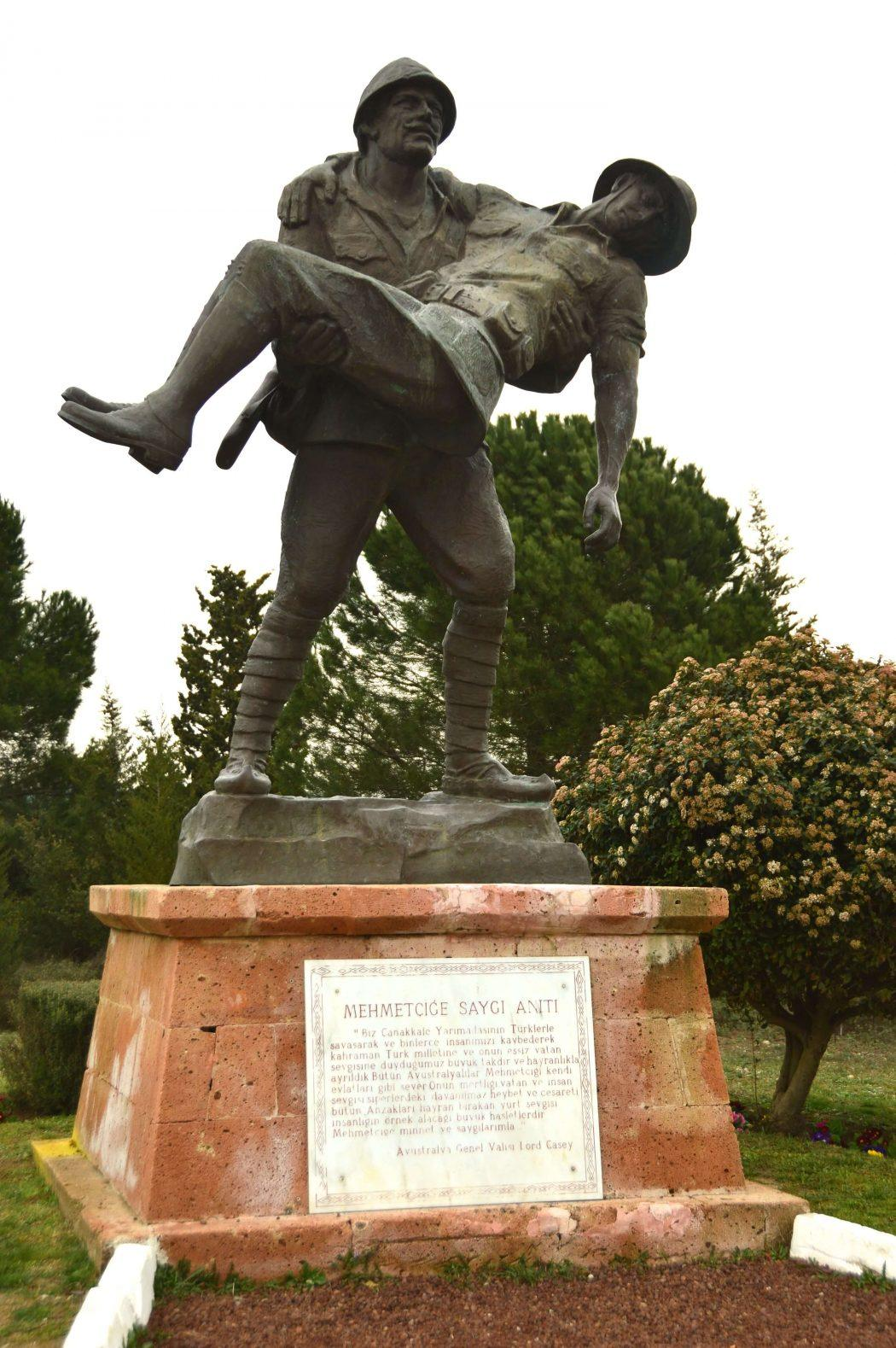 statue of one soldier carrying another on the gallipoli peninsula