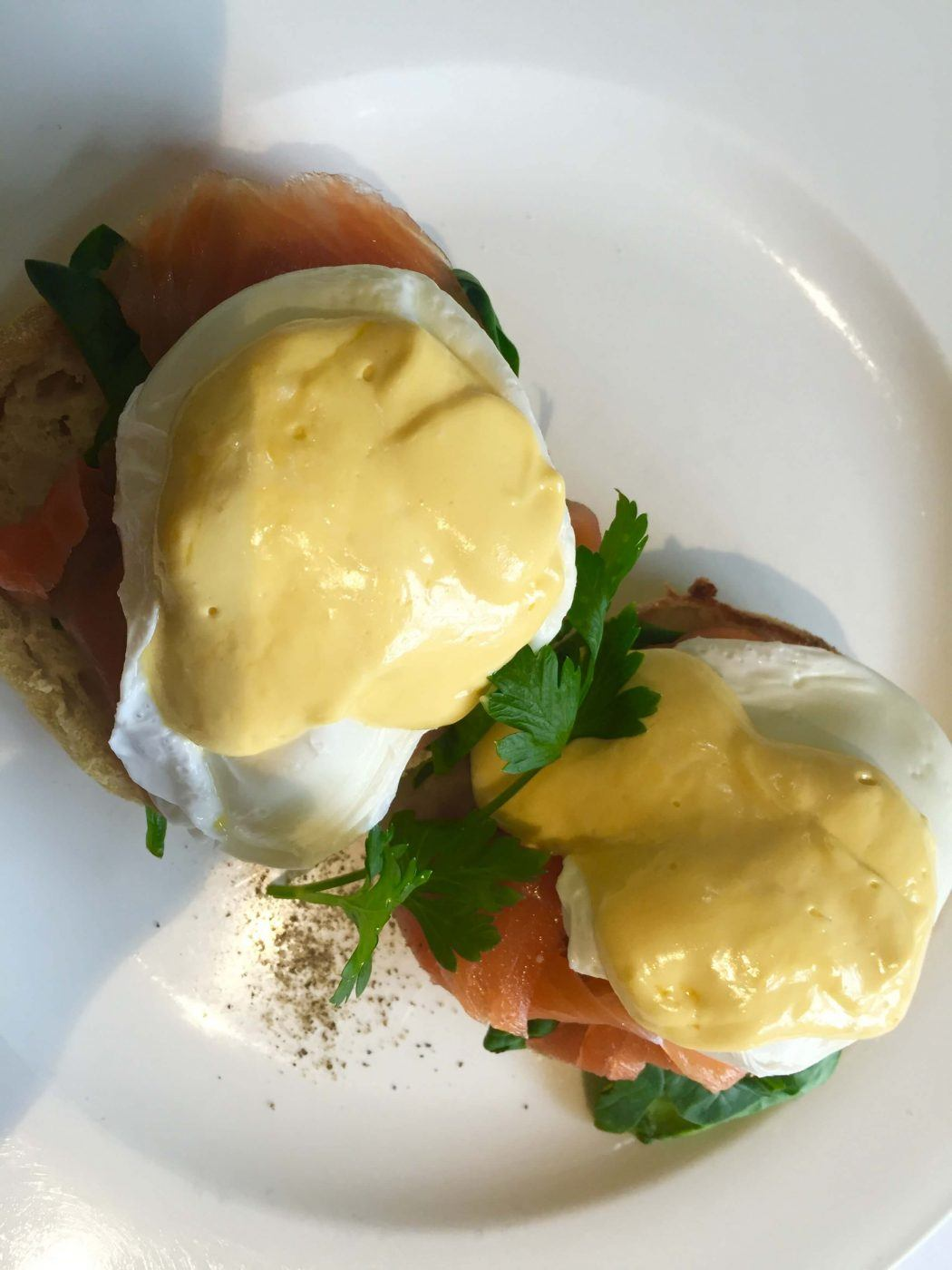 poached eggs with hollandaise sauce on a white plate at Links House