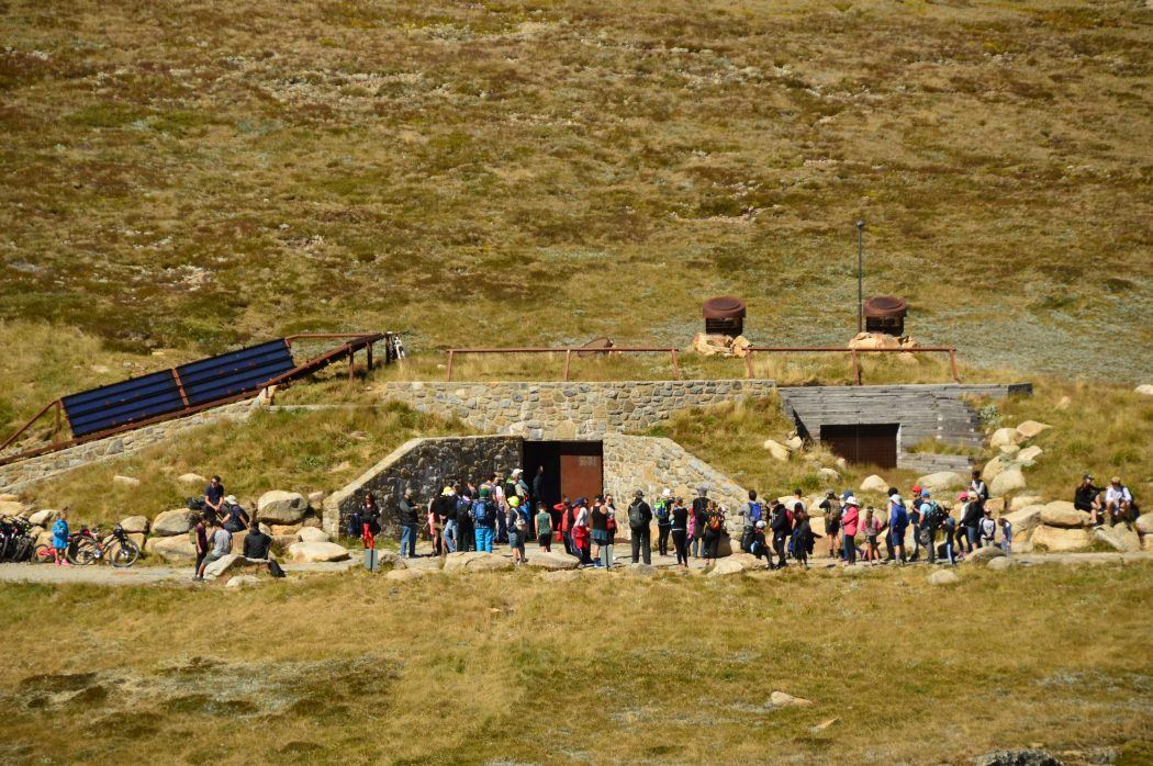 long queue of people waiting to use the highest toilet in australia on mount kosciuszko