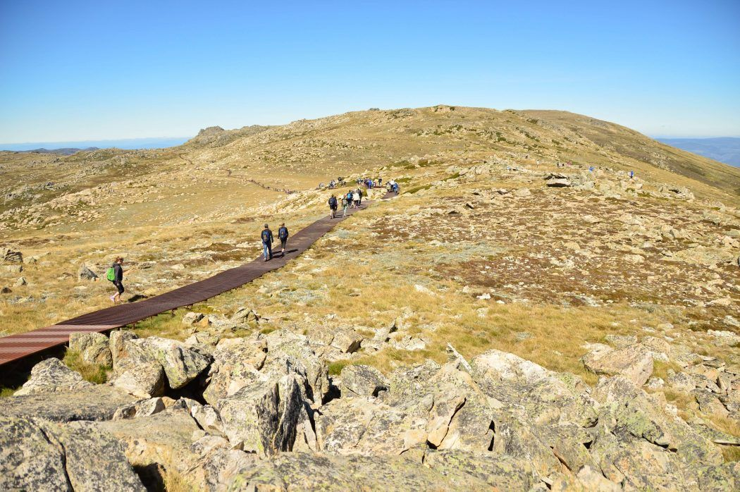people walking to the summit of Mount Kosciuszko - a great weekend getaway from Sydney