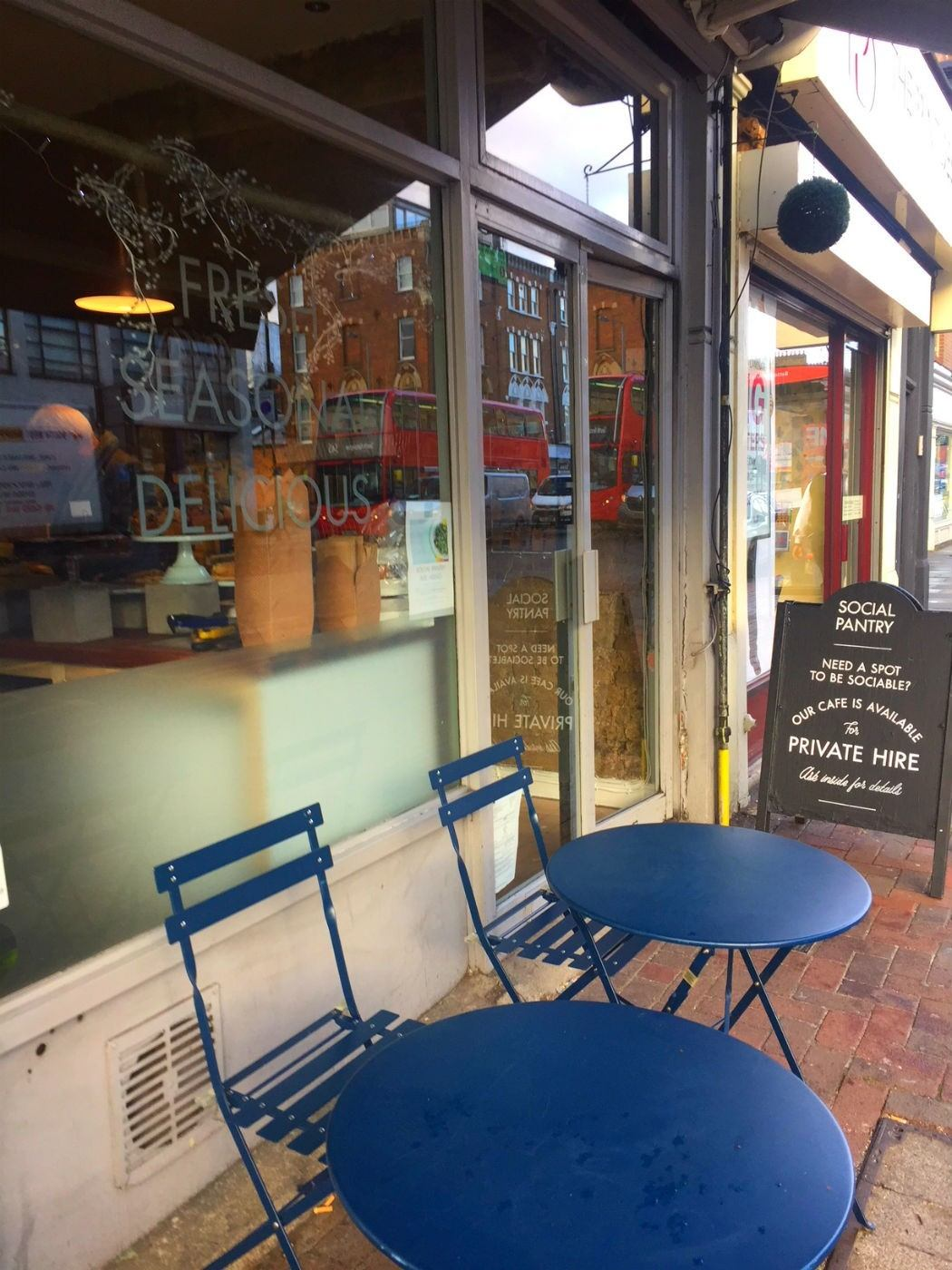 blue tables and chairs outside social pantry on lavender hill clapham