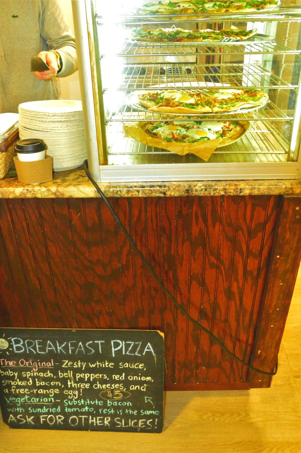 breakfast pizza sign and on display