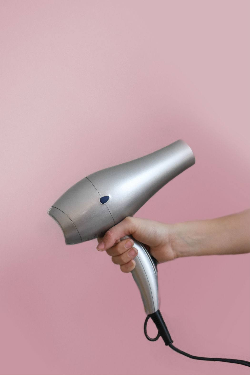 hand holds a travel hair dryer