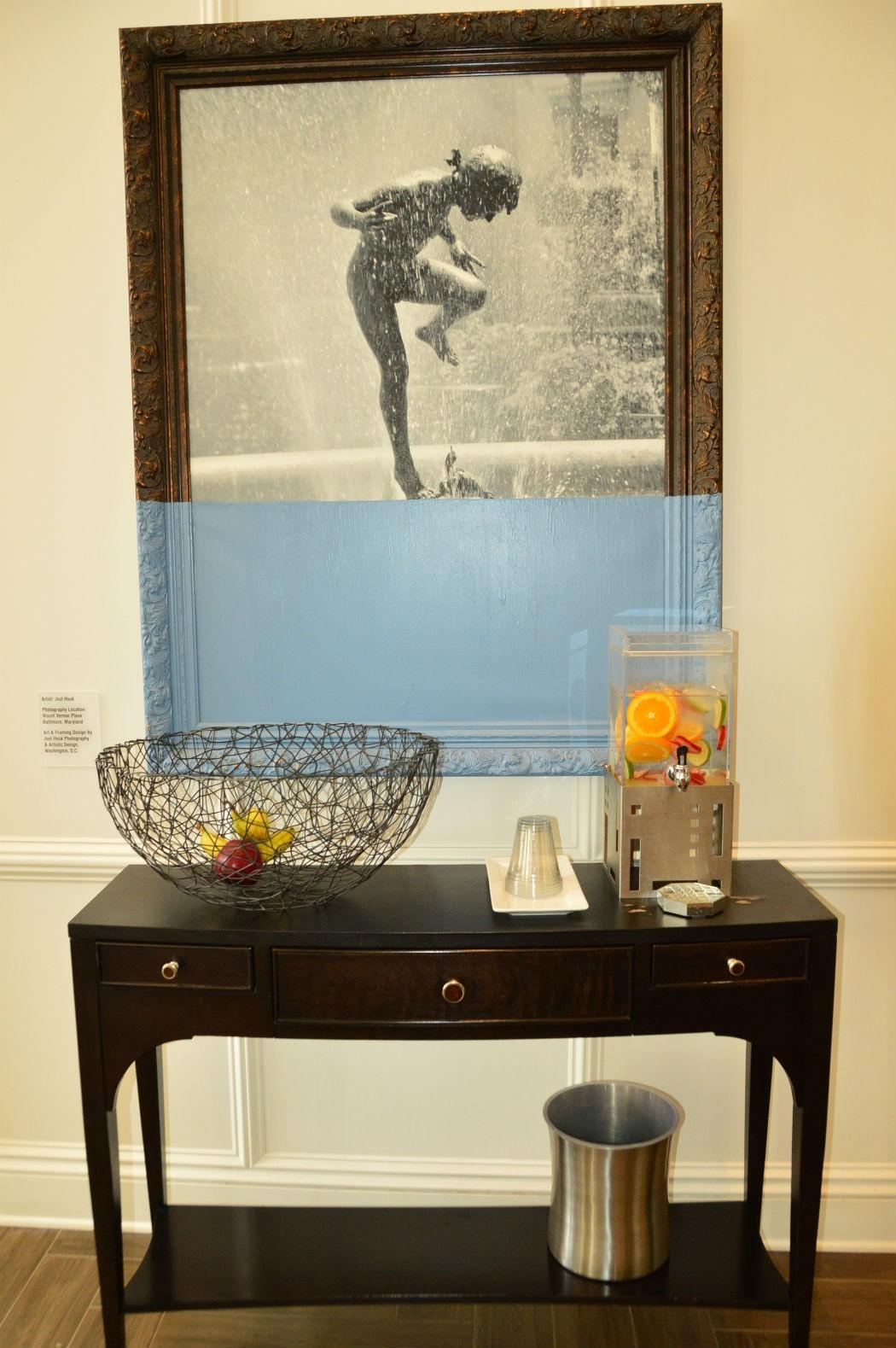 framed picture in front of table with water stand at hotel indigo