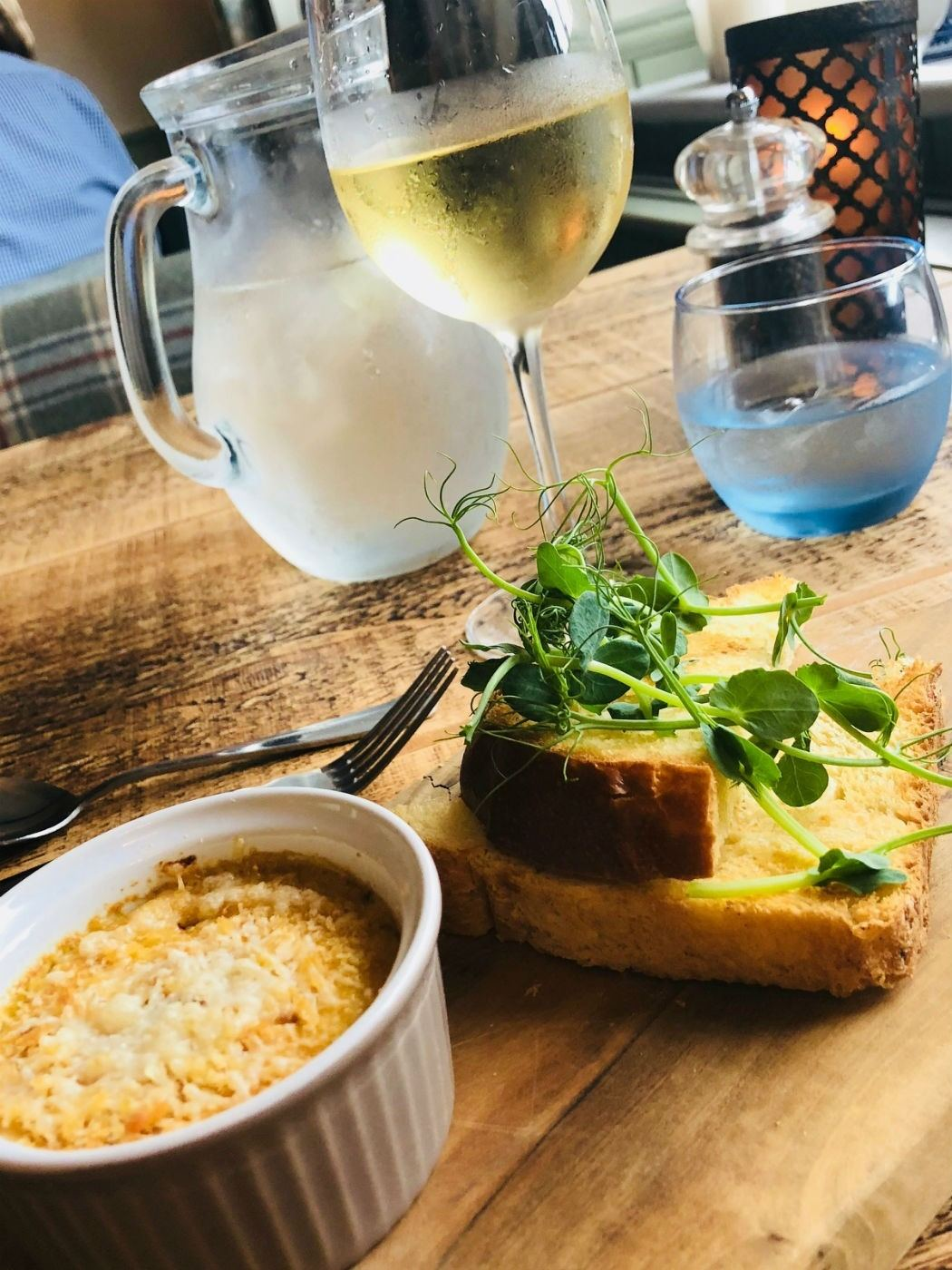 crab brulee with bread and wine and water at the bell inn