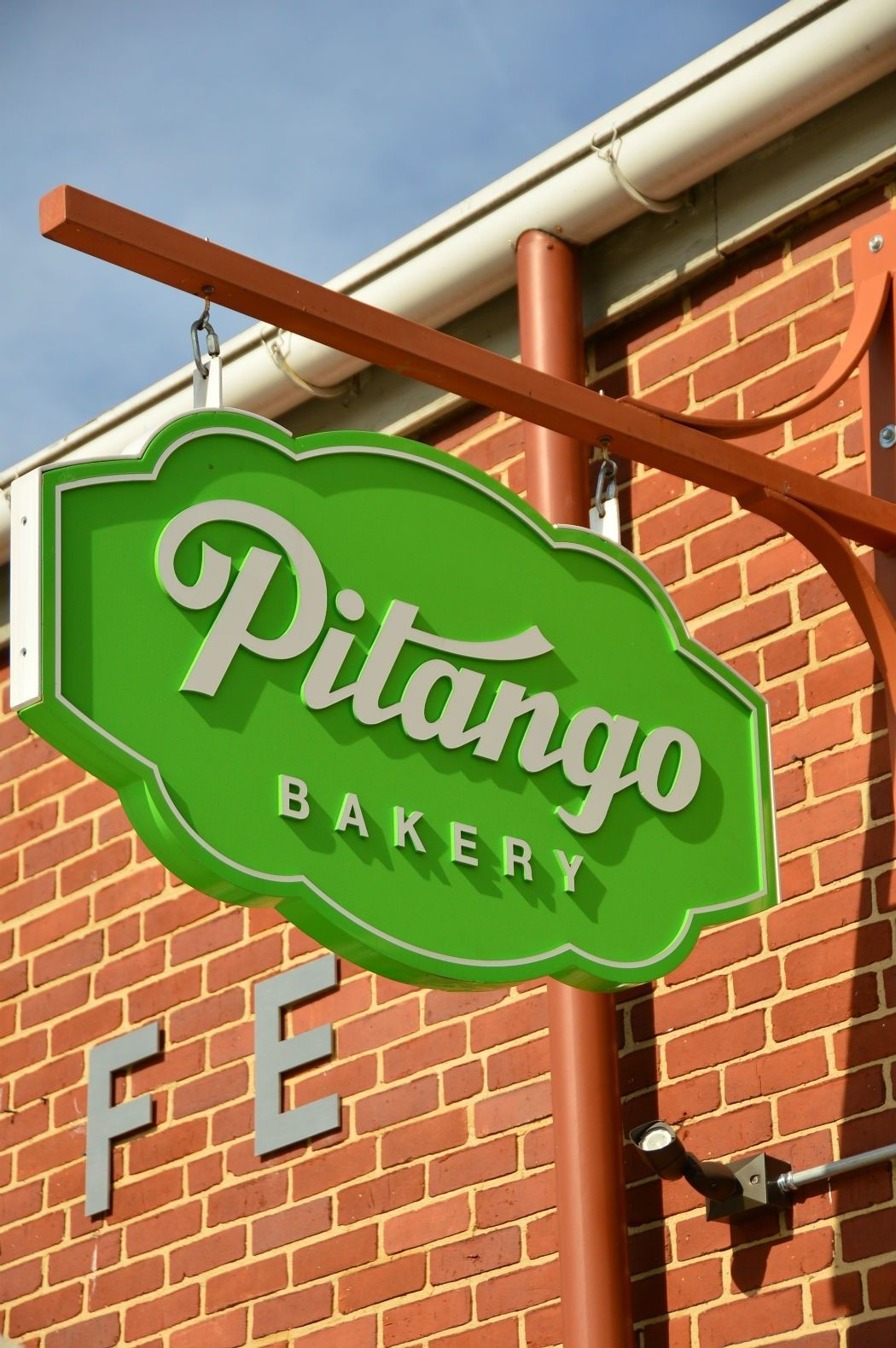 green sign for pitango bakery baltimore