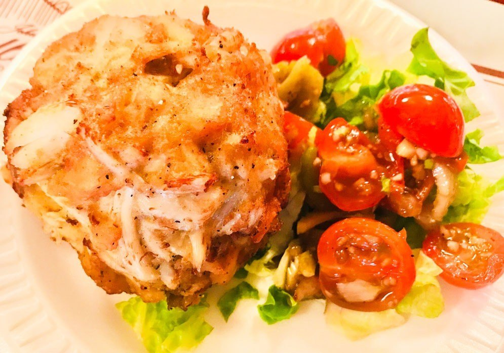 faidley crab cake with salad at lexington market baltimore