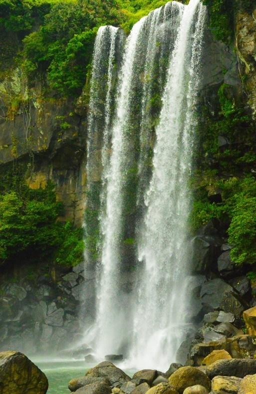 waterfall in seogwipo on jeju island korea