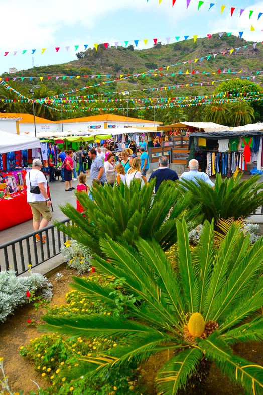 palm plant and people and market stalls at san mateo market gran canaria