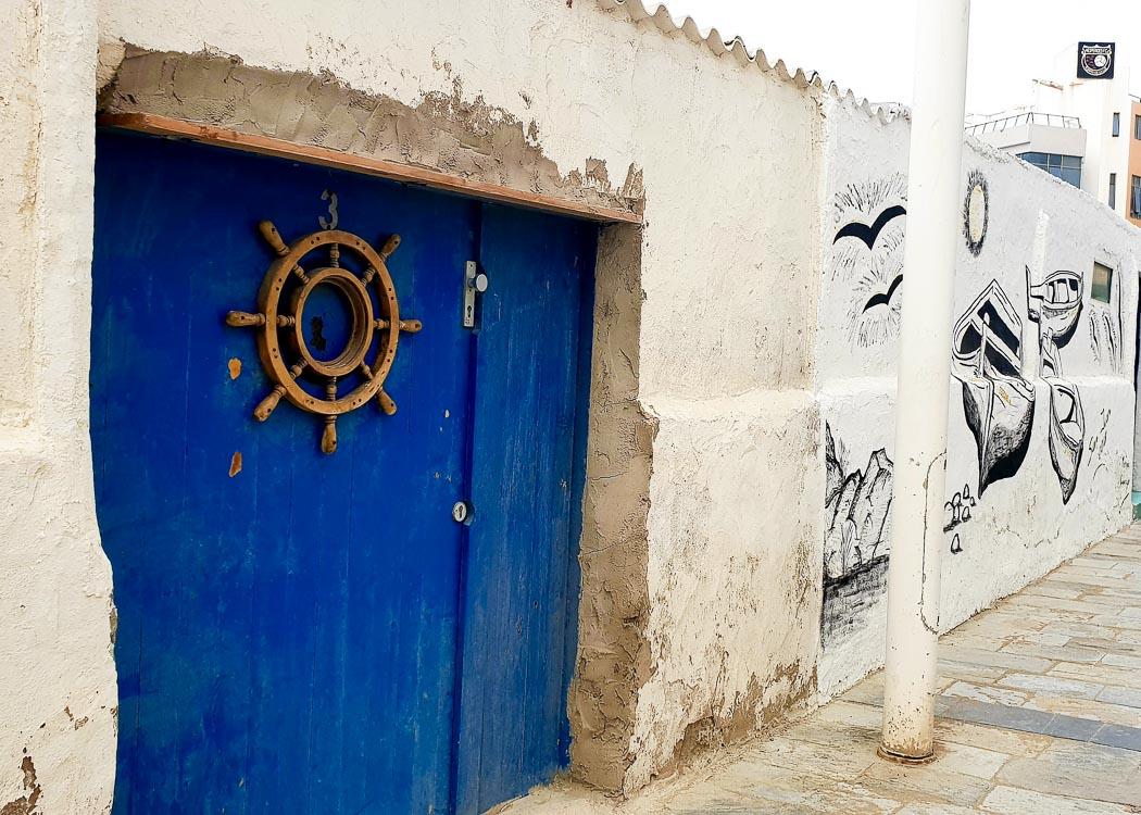 Blue door with wheel in Las Palmas Gran Canaria