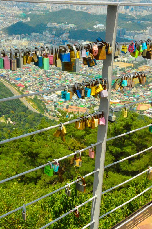 locks in front of a view of Daegu