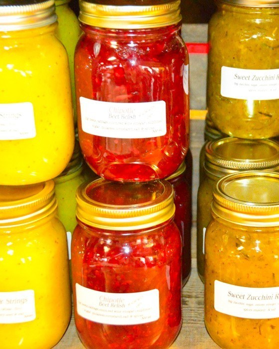 colourful jars of pickled products at Wolfville Farmer's Market
