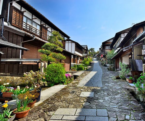 path and houses in a japanese village on the Nakasendo Trail