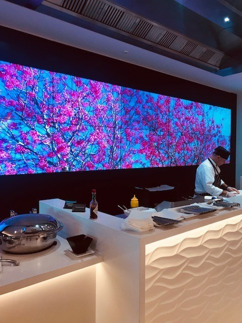 Food preparation station with big screen at the Air new zealand lounge sydney airport