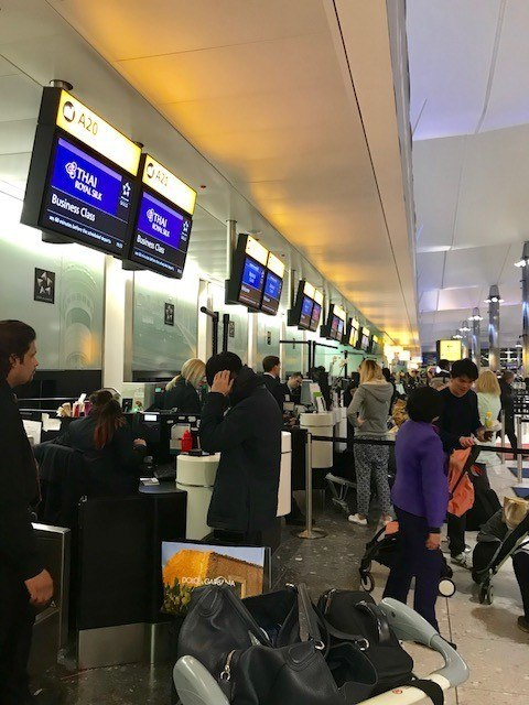 Check in desk for thai airways business class at London Heathrow Terminal 2