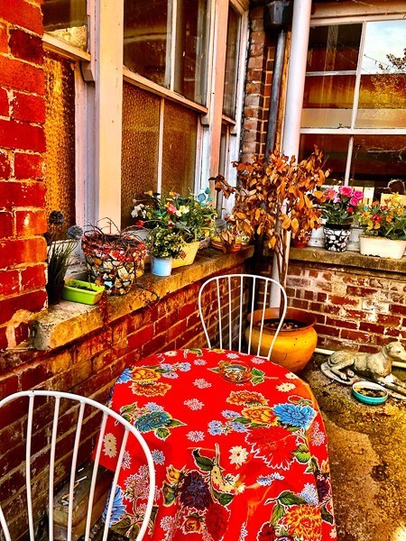 colourful outdoor seating area at Glorious Art House Coffee House Exeter