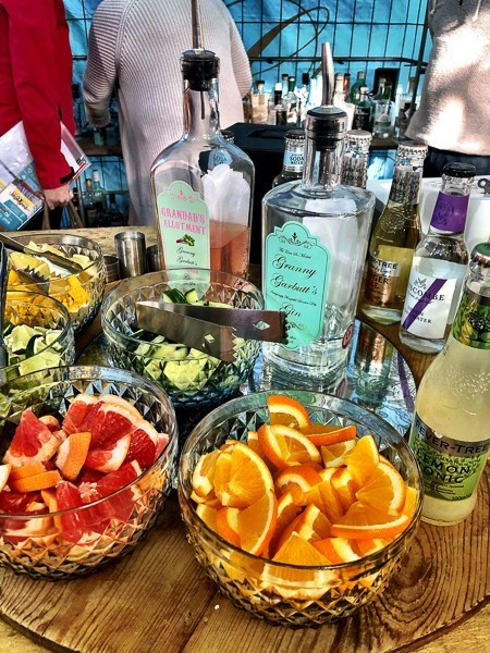 Gin Palace Exeter bottles of gin and fresh fruit