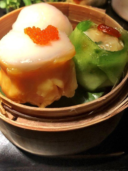 colourful dim sum in a basket at hakkasan