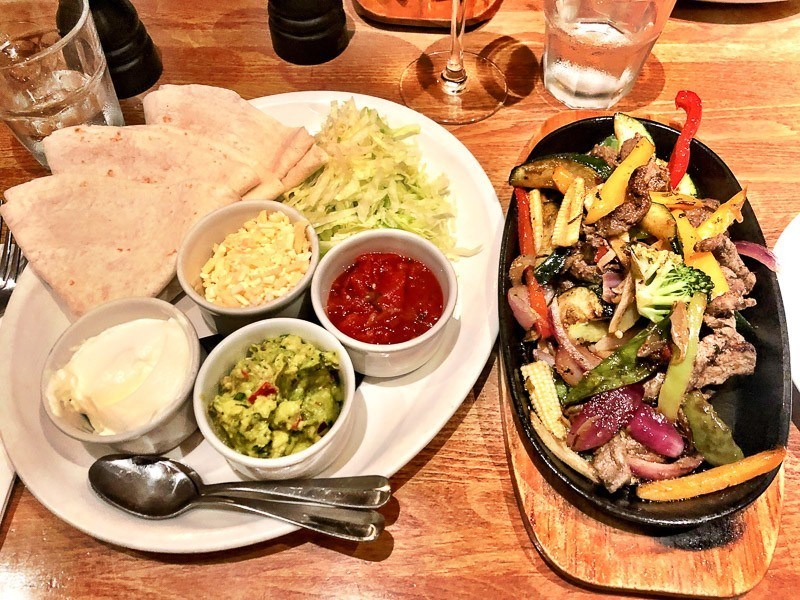 chicken fajitas on a table at Harry's Exeter