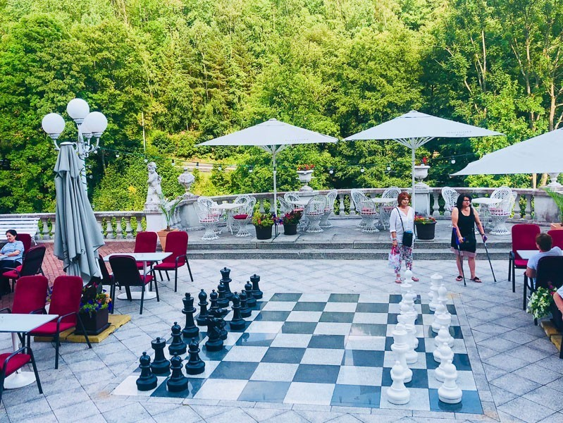hotel radon jachymov outdoor large chess set and umbrellas