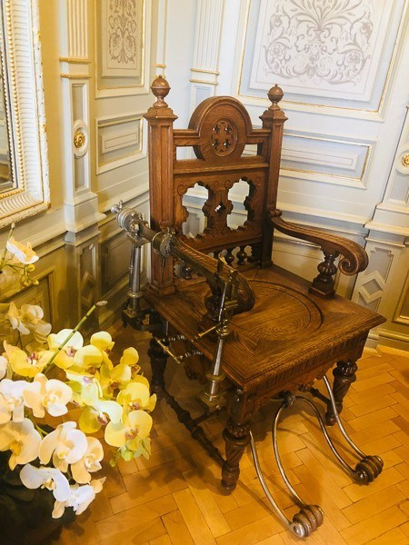 Edward VII's wooden chair in an elaborate room at Nove Lazne hotel
