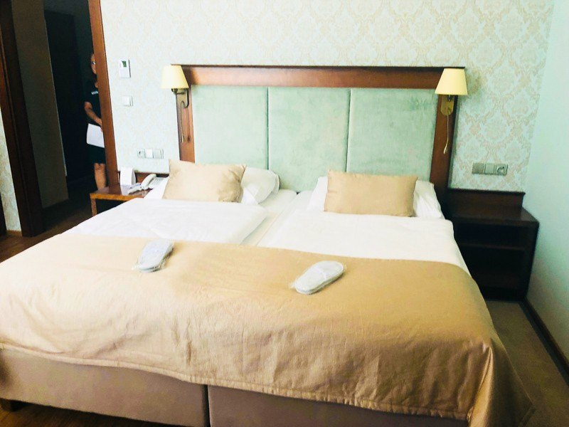 imperial hotel room double bed with slippers
