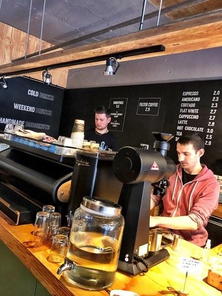 men behind big coffee machine and coffee menu at March coffee exeter