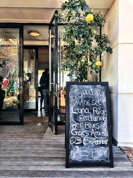 chalkboard outside a winery entrance