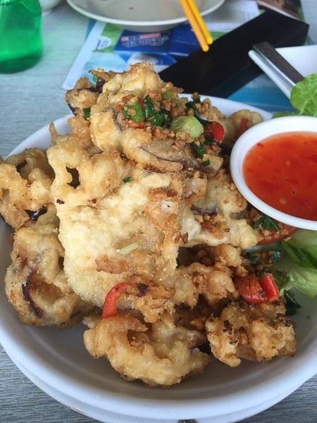 hong kong shek o thai calamari on white plate with chili sauce