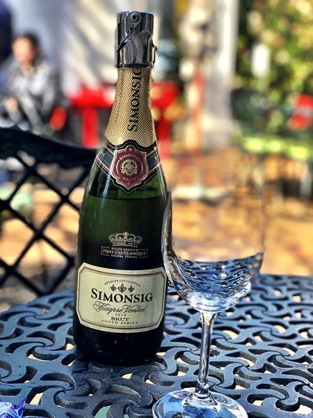 bottle of simonsig sparkling and a wine glass